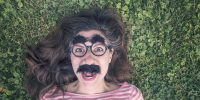 Girl with comedy glasses and mustache
