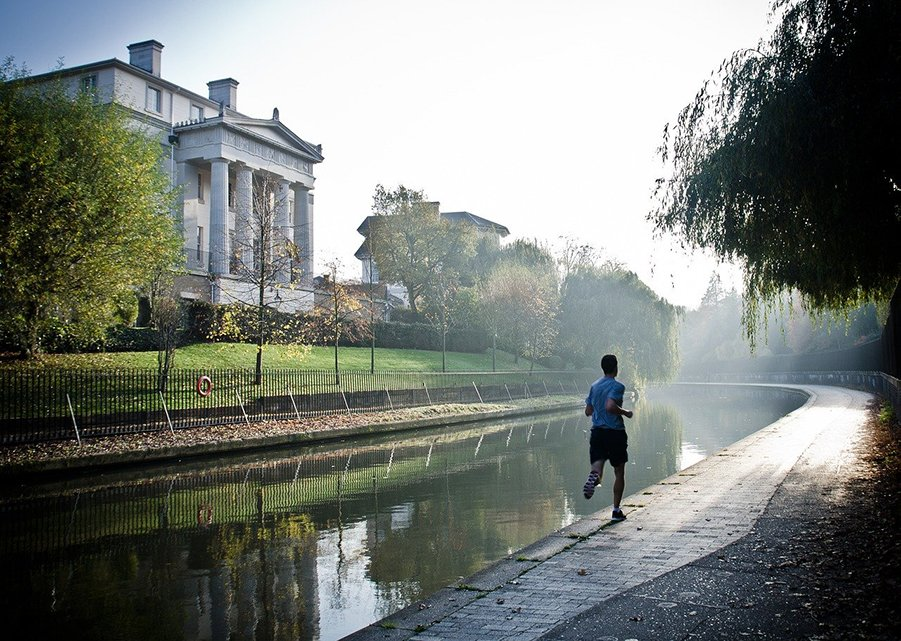 Man running by a canal